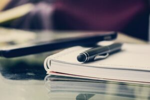 Pen and notebook to prepare for representing yourself in court