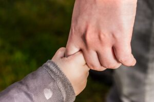Holding hands with a child